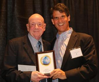 Dr. Raymond Moody receiving our first annual  Afterlife Awareness Award at our 2015  conference,   ​presented by Dr. Eben Alexande